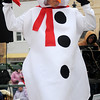 Kent Evatt celebrates his Candy Cane Cash costume contest win after running in the 5K Candy Cane Dash Saturday, Dec. 14, 2013. (Staff Photo by BONNIE VCULEK)