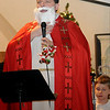 Rev. Joseph Irwin portrays Saint Nicholas during the students' Christmas program at St. Joseph Catholic School Tuesday, Dec. 17, 2013. The production was under the direction of Nancy Dillard. (Staff Photo by BONNIE VCULEK)