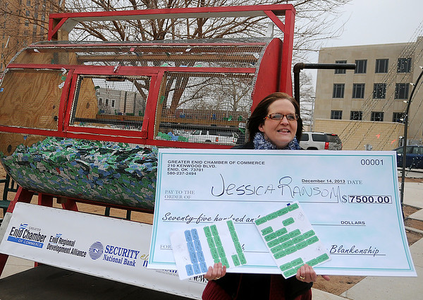 Jessica Ransom holds her 40 organized tickets and the grand prize check after she won the money during the 10th annual event Saturday, Dec. 14, 2013. Ransom will plan a trip to Disney World for her three daughters with her winnings. (Staff Photo by BONNIE VCULEK)