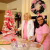 Alicia Vanhooser, MD (left), and Stephanie DeClerck enjoy the Pink Party at St. Mary's Women's Imaging Friday, Dec. 13, 2013. The Pink Ribbon facility has been recognized for excellence in breast health and exceptional commitment and support to the women our community. (Staff Photo by BONNIE VCULEK)