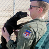 2nd Lt. Matthew Simpson receives a kiss from one of the puppies at the Enid Animal Control Wednesday, Dec. 18, 2013. Simpson, who is transferring from Vance Air Force Base to another in California, is considering adopting a pet. (Staff Photo by BONNIE VCULEK)