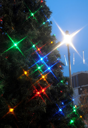 With the use of a four-point star filter, Christmas tree lights twinkle at dusk outside the Enid Event Center and Convention Hall Friday, Dec. 20, 2013. (Staff Photo by BONNIE VCULEK)