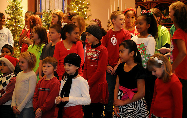 Garfield Elementary School honor choir awaits the beginning of their performance during Christmas in the Village at the Cherokee Strip Regional Heritage Center Friday, Dec. 6, 2013. (Staff Photo by BONNIE VCULEK)