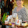 Barbara Whinery, MD, holds a tray of products that have been made by 4RKids Foundation employees as she pauses inside the 2nd Story Gift Shop at 702 Overland Trail Thursday, Dec. 19, 2013. Whinery is co-founder of the nonprofit organization that provides opportunities for children and adults with special needs. (Staff Photo by BONNIE VCULEK)