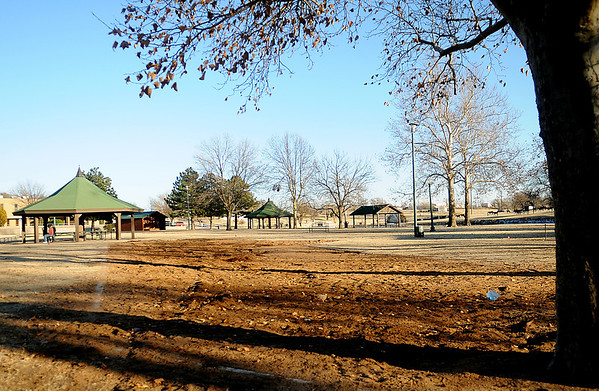 The old swings, merry-go-round and slide have been removed by city of Enid to make room for new playground equipment at Government Springs Park Friday, Dec. 27, 2013. (Staff Photo by BONNIE VCULEK)