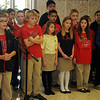 St. Joseph Catholic School 3rd-5th grade students entertain the guests with a medley of Christmas carols at Central National Bank Friday, Dec. 6, 2013. (Staff Photo by BONNIE VCULEK)