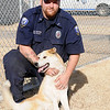 Enid Animal Control officer William Breeze kneels near a husky-mix puppy Wednesday, Dec. 18, 2013. Pets are available for adoption during the holiday season. (Staff Photo by BONNIE VCULEK)