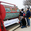 Enid High School football players turn the giant barrel of tickets during the 10th annual Candy Cane Cash drawing on the Garfield County Courthouse lawn Saturday, Dec. 14, 2013. (Staff Photo by BONNIE VCULEK)