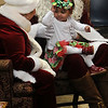 Tylyn Gay with Santa and Mrs. Claus during Breakfast with Santa Saturday, Dec. 7, 2013. (Staff Photo by BONNIE VCULEK)