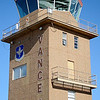 Part of the flight line and the covered top of the new control tower at Vance Air Force Base reflect in the old aircraft control tower glass Friday, Dec. 27, 2013. (Staff Photo by BONNIE VCULEK)