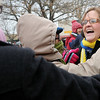 Jessica Ransom (right), a math teacher at Enid High School, receives hugs from friends after she won the $7500 grand prize during the 10th annual Candy Cane Cash on the Garfield County courthouse lawn Saturday, Dec. 14, 2013. (Staff Photo by BONNIE VCULEK)