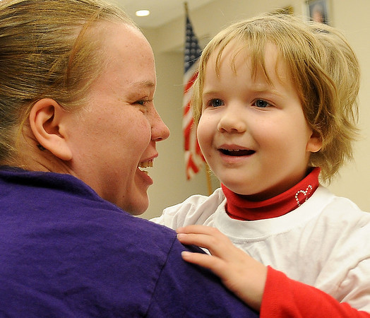 Kristina Carten rushes into her mother's arms after the Applewood Early Learning's Christmas program at the YWCA Friday, Dec. 13, 2013. (Staff Photo by BONNIE VCULEK)