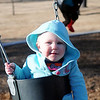 Isabel Dorrell (left) swings with friends at the new Champlin Park playground Saturday, Dec. 28, 2013. Families spent the day at the city parks as temperatures reached the lower 60s. (Staff Photo by BONNIE VCULEK)