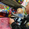 "Sgt. Greg Bergdall holds Joseph Orion, son of Mary Koehn, as they select toys together during ""Shop with a Cop"" at the Big K Mart Saturday, Dec. 14, 2013. Sixty-five children in the community received $100 each for Christmas shopping from the Enid Police Department and Oklahoma Highway Patrol. (Staff Photo by BONNIE VCULEK)"