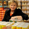Gail Wynne, chairwoman of the board for Loaves & Fishes, pauses in the warehouse Friday, Dec. 20, 2013. Wynne is a Pillar of the Plains finalist. (Staff Photo by BONNIE VCULEK)