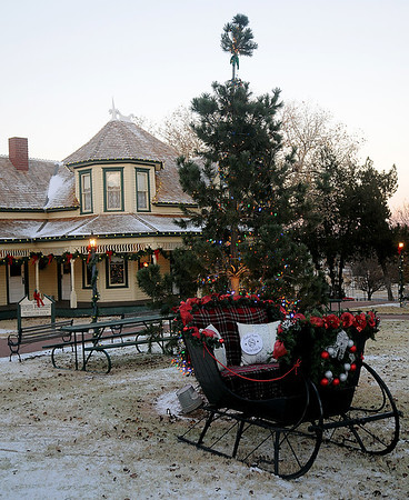 Lights adorn Christmas trees and the 1905 Glidewell House during Christmas in the Village at the Cherokee Strip Regional Heritage Center Friday, Dec. 6, 2013. (Staff Photo by BONNIE VCULEK)