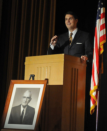 Mike Fields, Garfield County District Attorney and a former Waller Junior High student, presents the keynote address during Waller Day festivities Friday, Dec. 6, 2013. (Staff Photo by BONNIE VCULEK)