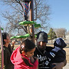 Mari Lupercio (left) keeps a watchful eye on her daughter, Ximena (top), as her husband, Mario, lowers Camila and Mateo to the ground during their play time at Champlin Park Saturday, Dec. 28, 2013. Temperatures reached the lower 60s Saturday, before freezing temperatures arrive Sunday. (Staff Photo by BONNIE VCULEK)