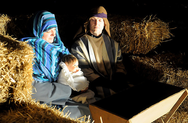 Carrie and Chad Rudd portray Mary and Joseph during Enid First Nazarene Church's living drive-through nativity Friday, Dec. 13, 2013. The final night of the visual reenactment of the truth of Christmas will be Sunday evening at 324 N. Cleveland. (Staff Photo by BONNIE VCULEK)