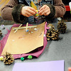 Jaden Severe (top) and her mother, Kenna (bottom) create artistic masterpieces during their tour of Leonardo's Children's Museum Friday, Dec. 27, 2013. Several locations in Enid offer activities for school-age children during the Christmas break. (Staff Photo by BONNIE VCULEK)