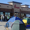 Chick-fil-A patrons line up outside the new location at 4329 W. Owen K. Garriott Wednesday, Dec. 11, 2013. One hundred are expected to camp in freezing temperatures until the doors open at 6 a.m. Thursday. (Staff Photo by BONNIE VCULEK)