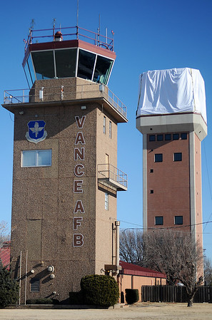 From the flight line, the old aircraft control tower (left) at Vance Air Force Base appears in front of the new one (right), that is currently under construction Friday, Dec. 27, 2013. (Staff Photo by BONNIE VCULEK)
