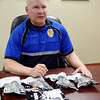 Lt. Gary Fuxa with the Enid Police Department discusses the contents of the trauma kits purchased for 61 officers by the Enid Masonic Lodge Thursday, Dec. 11, 2014. (Staff Photo by BONNIE VCULEK)
