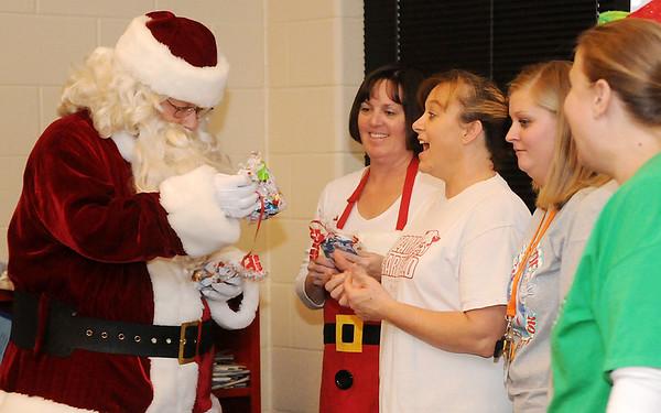 Santa delivers gifts to Garfield Elementary School teachers Friday, Dec. 19, 2014. (Staff Photo by BONNIE VCULEK)