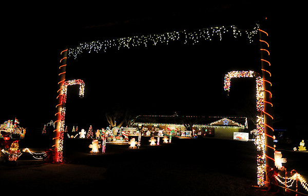 Ten foot tall candy canes created with pvc pipe and Christmas lights frame part of the Buffalo Springs Ranch holiday light display north of Bison Saturday, Dec. 20, 2014. (Staff Photo by BONNIE VCULEK)