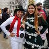 Candy Cane Cash patrons sport festive attire in downtown Enid Saturday, Dec. 13, 2014. (Staff Photo by BONNIE VCULEK)