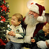 The Habibi boys pause for a portrait with Santa during Humphrey Abstract Christmas in the Village at the Cherokee Strip Regional Heritage Center Friday, Dec. 5, 2014. (Staff Photo by BONNIE VCULEK)