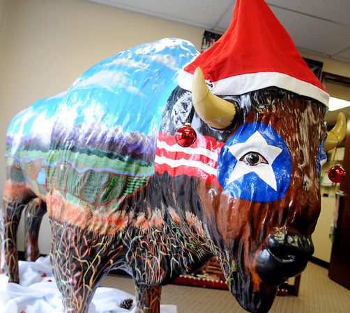 Prairie Thunder, by artist Cindy Van Kley, dons festive Christmas decorations at Visit Enid Wednesday, Dec. 10, 2014. (Staff Photo by BONNIE VCULEK)