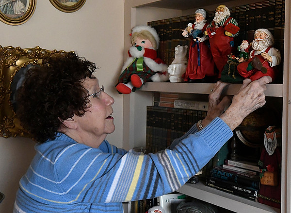 Evelyn Crawford points out one of her favorite Christmas decorations during an interview at her home Wednesday December 21, 2016. (Billy Hefton / Enid News & Eagle)