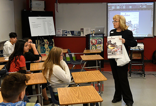 Cheryl Cooksey, graphic arts instructor at Autry Technology Center, talks to students during Eighth Grade Career Day at Longfellow Middle School Friday December 9, 2016. (Billy Hefton / Enid News & News)