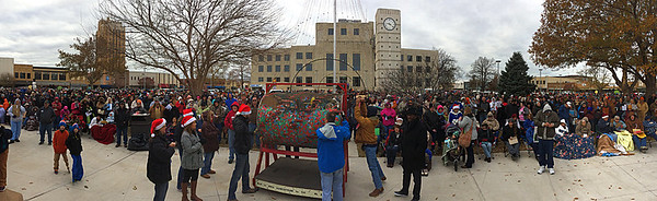 A panoramic image of the Candy Cane Cash drawing Saturday December 10, 2016 on the Garfield County Courthouse lawn. (Billy Hefton / Enid News & Eagle)
