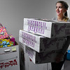 Home school student, Charity Davis, carries boxes from the warehouse while volunteering at Toys for Tots Monday December 5, 2016. (Billy Hefton / Enid News & Eagle)