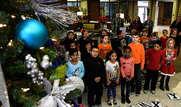 Second graders from McKinley Elementary sing during the open house at Security National Bank Wednesday December 7, 2016. (Billy Hefton / Enid News & Eagle)