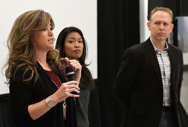 """Jenny Holtzclaw answers a question as Michelle Malkin and Brain Bates stand near during a Q&A section following a screening of """"Daniel in the Den"""" Saturday December 10, 2016 at the Central National Bank Center. (Billy Hefton / Enid News & Eagle)"""