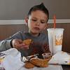 Jase Dershem dips a nugget in sauce while eating at Burger King Thursday December 1, 2016. (Billy Hefton / Enid News & Eagle)