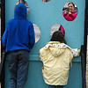 Logan Guerra takes photos of her kids, Jacob and Destiny, in one of the cutouts on the Garfield County Courthouse lawn Thursday December 22, 2016. (Billy Hefton / Enid News & Eagle)