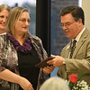 Kathy Piper,of Longfellow Middle School, recieves a plaque from Enid Public School superintendent, Dr. Darrel Floyd, after being named Enid Public Schools Support Personnel of the Year during the Enid Public School Foundation's Education Celebration Wednesday at Prairie View Elementary. (Billy Hefton / Enid News & Eagle)