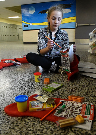 Waller Middle School seventh grader, Tristin Hawley, fills stocking Friday December 16, 2016 as part of the Waller Gives To Others program. (Billy Hefton / Enid News & Eagle)