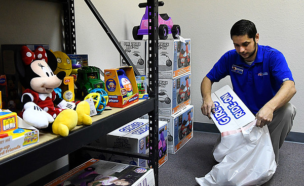 Nathan D'andrea from Pets Mart fills an order at Toys for Tots Monday December 5, 2016. Orders were being filled for children of inmates at the Garfield County Jail. (Billy Hefton / Enid News & Eagle)