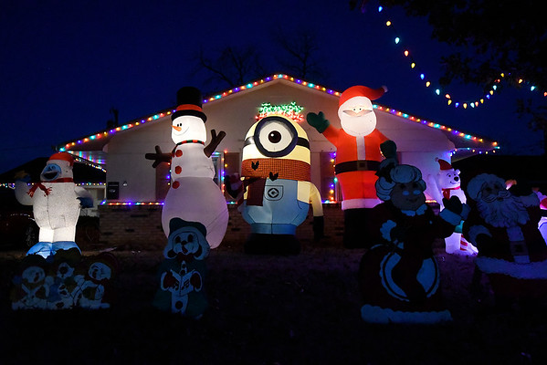 Large inflatables fill the yard of a house on Margaret Circle Wednesday December 20, 2016. (Billy Hefton / Enid News & Eagle)