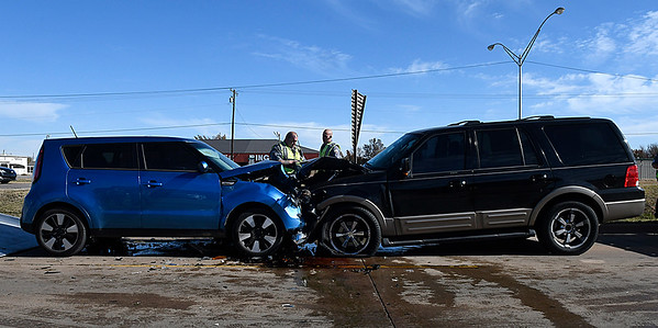 Enid police officers work an accident on the west access road of north Van Buren near Willow Thursday December 1, 2016. (Billy Hefton / Enid News & Eagle)
