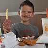 Jase Dershem holds up a french fry while eating at Burger King Thursday December 1, 2016. (Billy Hefton / Enid News & Eagle)