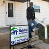 Joe Bradford stands on the steps of his home at 501 E. Iowa that was damaged by a house fire in May 2017. Volunteers from Habitat for Humanity have helped in the reconstruction of the house. (Billy Hefton / Enid News & Eagle)