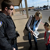 Kristie Young amd Rylee Young opens a card from Enid police officer Jordan Nichols that contained cash from an anonymous donation. (Billy Hefton / Enid News & Eagle)