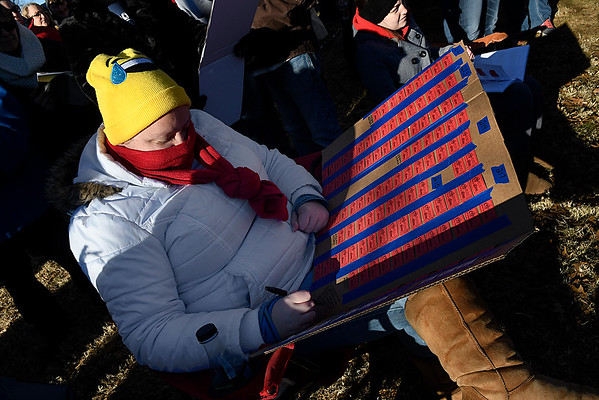Julie Ruckel checks her ticket in the Candy Cane Cash drawing Saturday December 9, 2017 on the Garfield County Courthouse lawn in downtown Enid. (Billy Hefton / Enid News & Eagle)