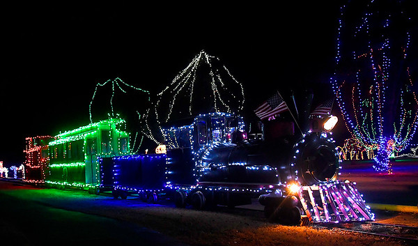 A train moves through Kingfisher Winter Nights Monday December 3, 2018. The light display runs through December 24, opening at 6 p.m. each night. Tickets for the train rides are $3. (Billy Hefton / Enid News & Eagle)